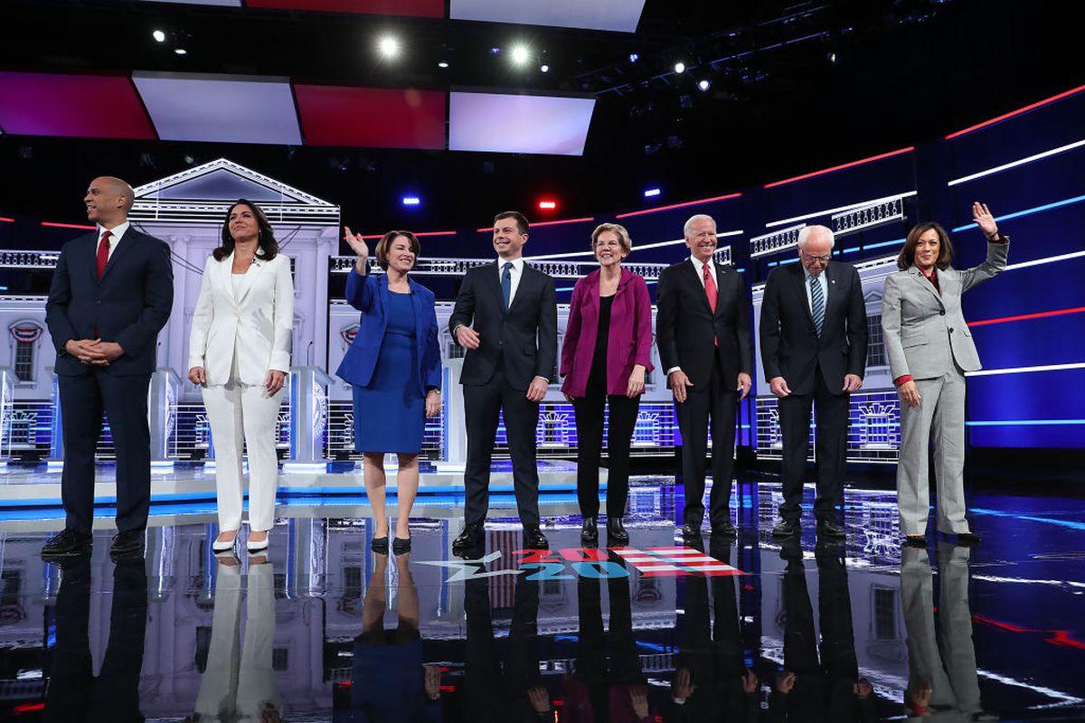ATLANTA, GEORGIA - NOVEMBER 20: Democratic presidential candidates (L-R) Sen. Cory Booker (D-NJ), Rep. Tulsi Gabbard (D-HI), Sen. Amy Klobuchar (D-MN), South Bend, Indiana Mayor Pete Buttigieg, Sen. Elizabeth Warren (D-MA), former Vice President Joe Biden, Sen. Bernie Sanders (I-VT), and Sen. Kamala Harris (D-CA), arrive on stage before the start of the Democratic Presidential Debate. (Photo by Joe Raedle/Getty Images)