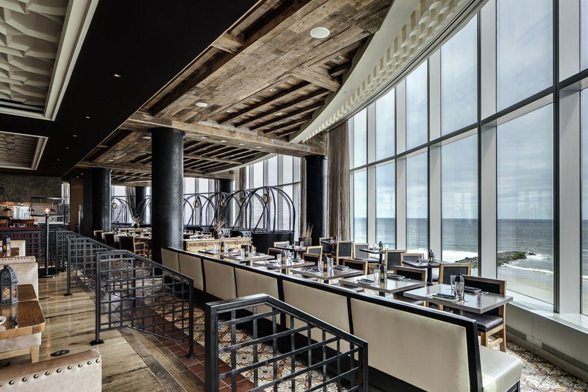 restaurant with big windows looking onto ocean
