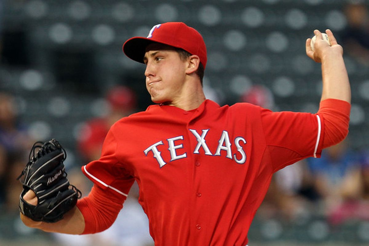 Derek Holland may soon find himself back in Oklahoma City.  (Photo by Ronald Martinez/Getty Images)