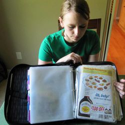 In this photo taken Tuesday, June 28, 2011, Monica Knight, a dental hygienist and mother of two, shows her coupon binder at her home in Boise, Idaho. Knight, a  used to spend spent $600 a month on groceries.  Thanks to extreme couponing she's down to $100-150 a month.
