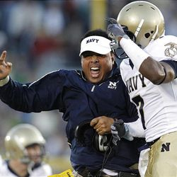 Navy head coach Ken Niumatalolo, left, reacts with safety Emmett Merchant following a turnover by Notre Dame, Saturday, Nov. 7, 2009.