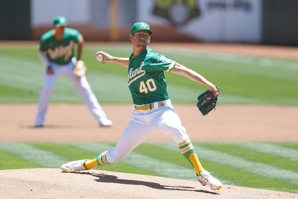 Chris Bassitt #40 of the Oakland Athletics pitches against the Kansas City Royals at RingCentral Coliseum on June 13, 2021 in Oakland, California.