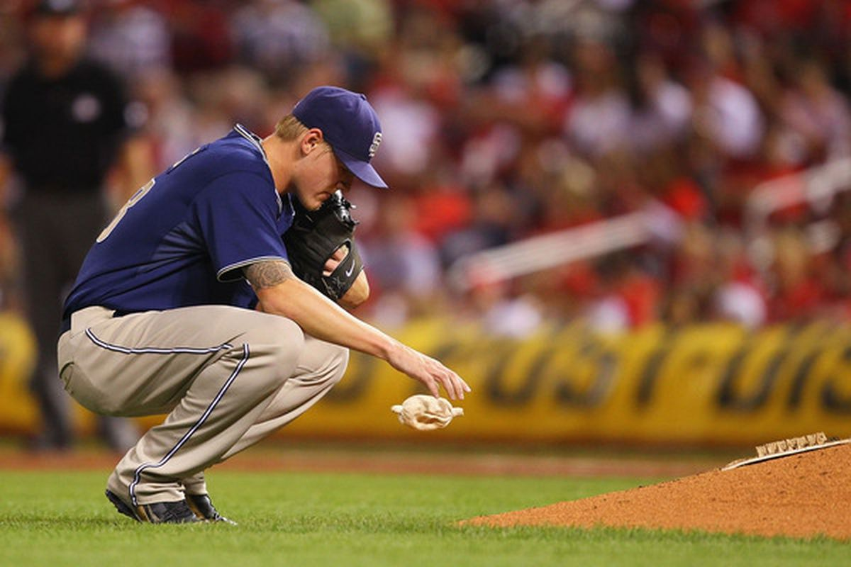 ST. LOUIS - SEPTEMBER 17: Starter Matt Latos #38 of the San Diego Padres regroups after giving up consecutive hits against the St. Louis Cardinals at Busch Stadium on September 17 2010 in St. Louis Missouri.  (Photo by Dilip Vishwanat/Getty Images)