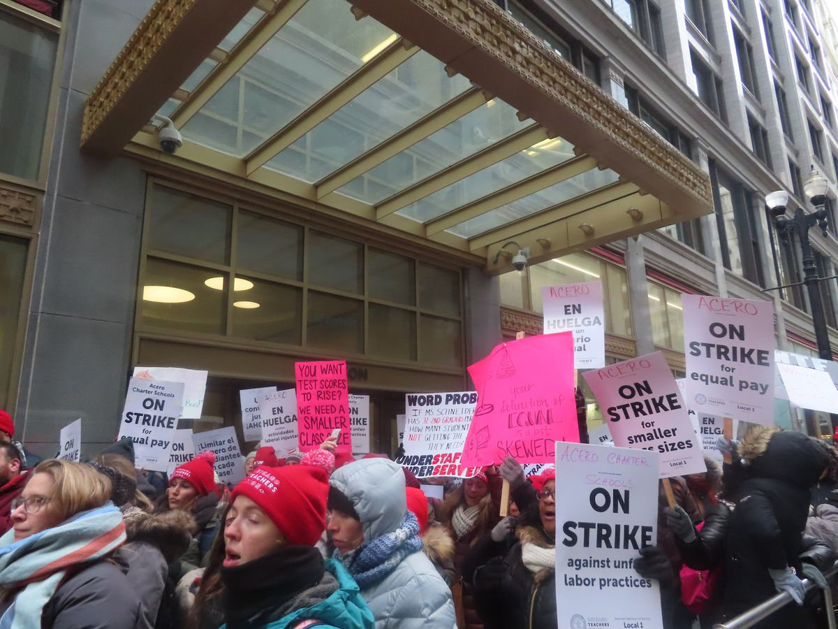 Teachers picket in front of Chicago Public Schools headquarters on the second day of the Acero teachers strike.
