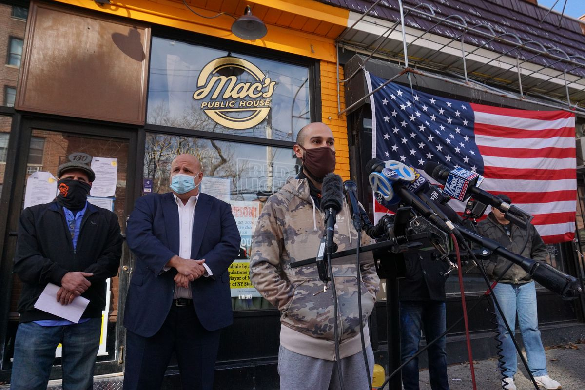 Danny Presti, a co-owner of Mac's Public House, speaks in front of his restaurant, Dec. 7, 2020.
