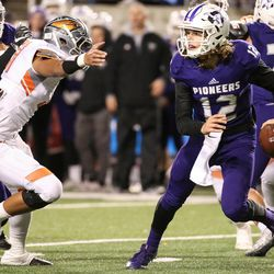 Lehi's Cammon Cooper (12) comes under pressure as Lehi and Skyridge face off in the 5A football state championship game at Rice-Eccles Stadium in Salt Lake City on Friday, Nov. 17, 2017.