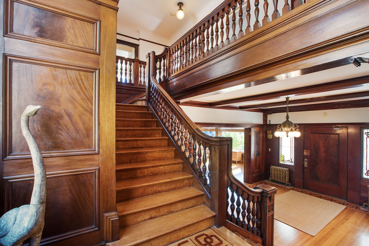 A staircase with intricate woodwork.