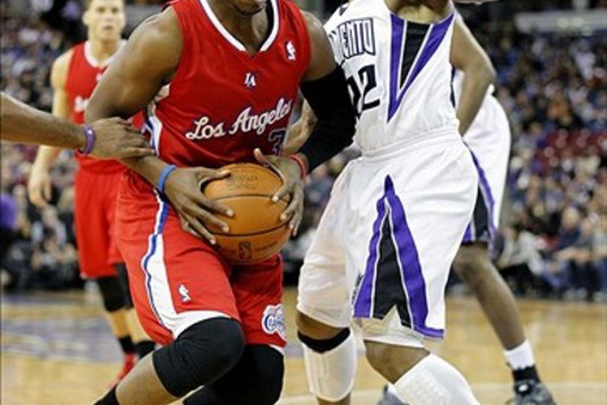 March 1, 2012; Sacramento, CA, USA; Los Angeles Clippers guard Chris Paul (3) drives past Sacramento Kings guard Isaiah Thomas (22) in the first quarter at the Power Balance Pavilion. Mandatory Credit: Cary Edmondson-US PRESSWIRE