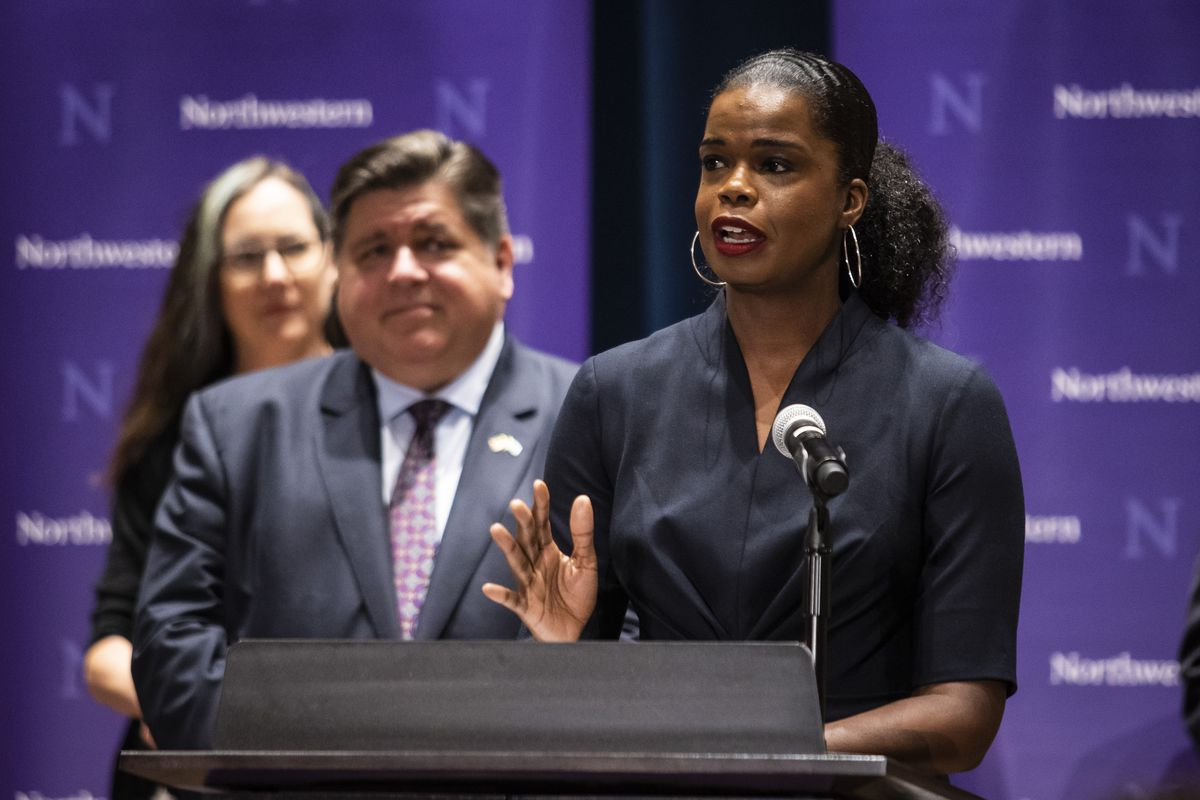 Cook County State's Attorney Kim Foxx speaks at a news conference at Northwestern's Pritzker School of Law, Thursday morning, as Gov. J.B. Pritzker looks on.