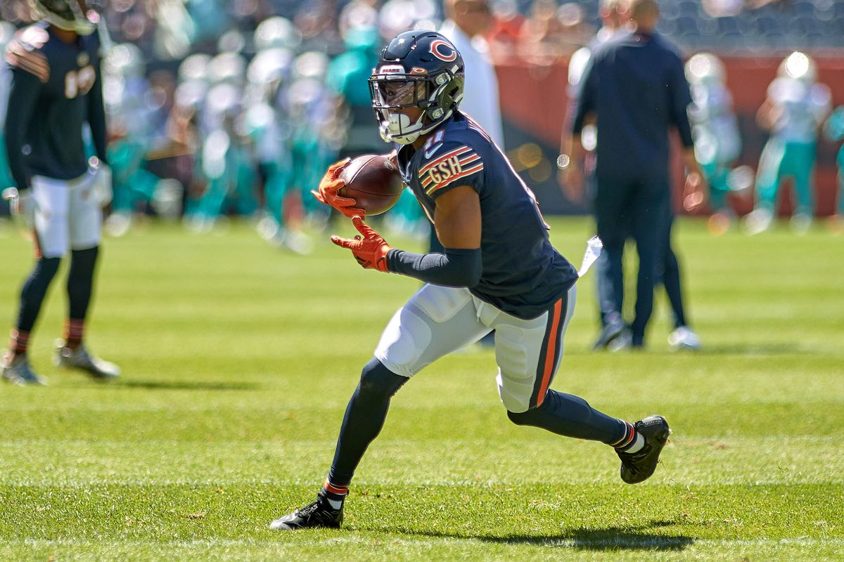 Chicago Bears wide receiver Darnell Mooney (11) runs with the football in warmups during a preseason game between the Chicago Bears and the Miami Dolphins on August 14, 2021 at Soldier Field in Chicago, IL.