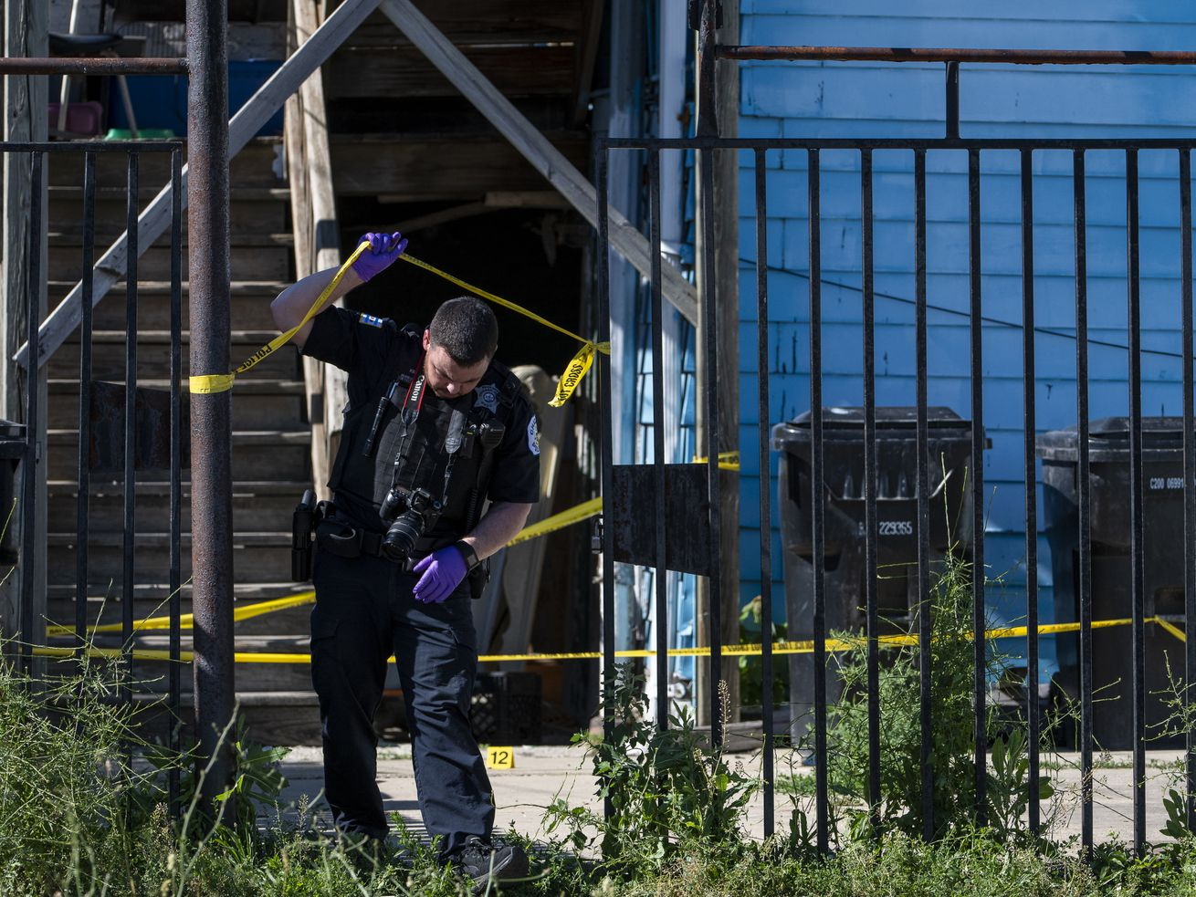 Chicago police work the scene where a 14-year-old by was shot and killed in the 1100 block of South Karlov Ave, in the Lawndale neighborhood, Thursday, June 10, 2021. | Tyler LaRiviere/Sun-Times
