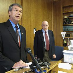 North Dakota Attorney General Wayne Stenehjem, left, speaks while North Dakota Secretary of State Al Jaeger listens at a news conference on the results of an investigation into petition fraud, Tuesday, Sept. 4, 2012 in Stenehjem's office at the Capitol in Bismarck, N.D., Two proposed ballot measures _ to create a North Dakota conservation fund and make marijuana use legal for medical treatments _ were disqualified from the ballot because hundreds of the initiative petition signatures were allegedly forged or made up. Eight North Dakota State University football players are among the 11 petition circulators who are facing charges.
