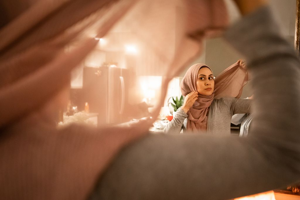 Felicia Salameh finishes putting on her headscarf at her Orland Park, IL home. She was raised in a Mexican-Muslim household and recently fully embraced Islam. | Maria de la Guardia / Sun-Times