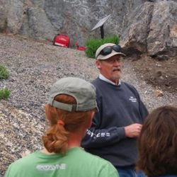 David Madsen, a retired state archaeologist, tells the story of how Danger Cave got its current name. The rocks that fell are in the background.