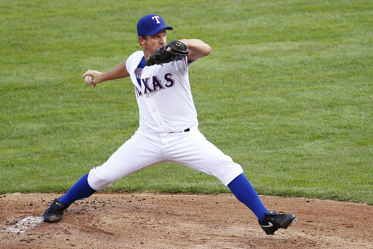 ARLINGTON, TX - JUNE 22: Roy Oswalt #44 of the Texas Rangers delivers a pitch against the Colorado Rockies at Rangers Ballpark during a interleague  game in Arlington on June 22, 2012 in Arlington, Texas. (Photo by Rick Yeatts/Getty Images)