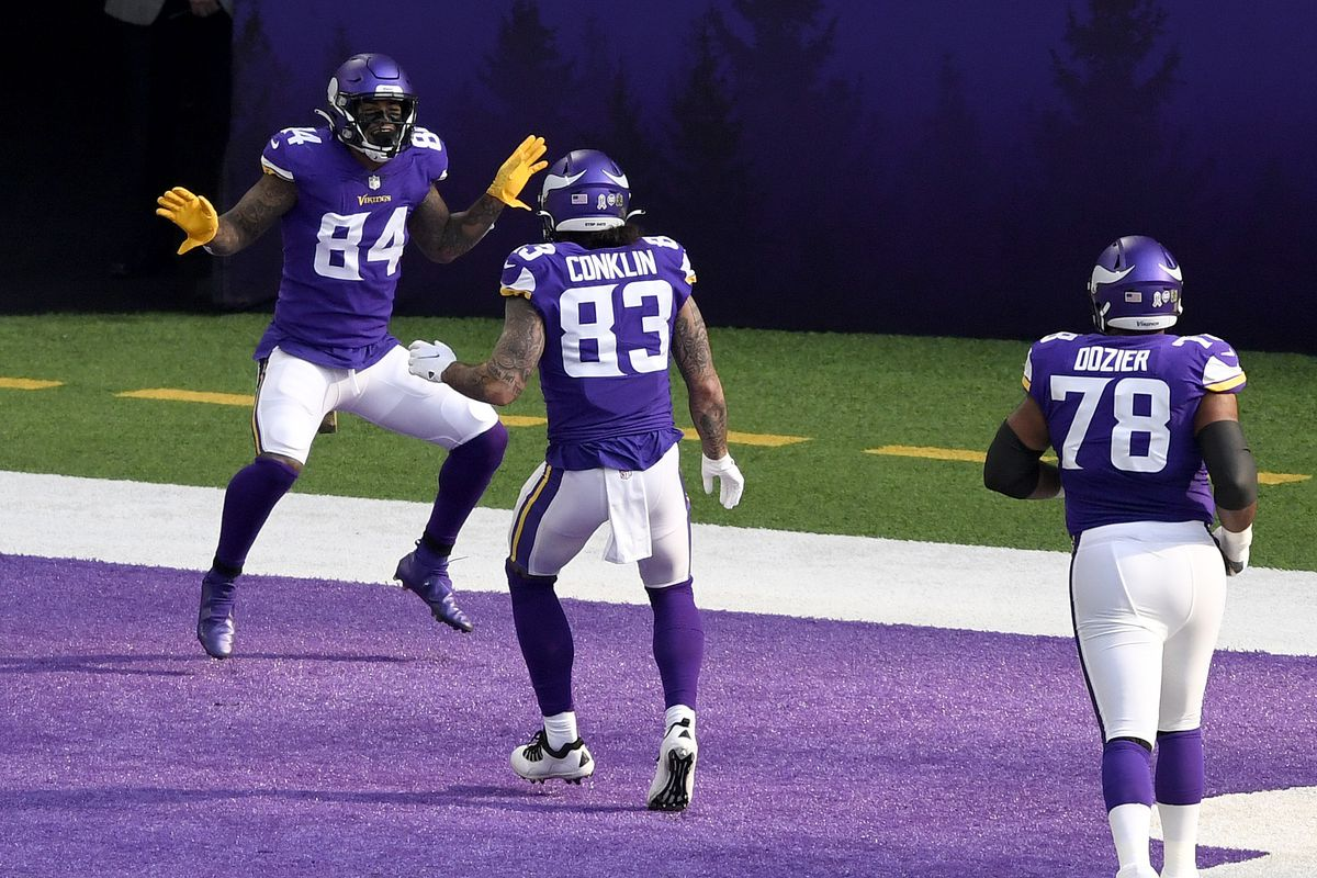Irv Smith Jr. #84 of the Minnesota Vikings celebrates with Tyler Conklin #83 after he caught a touchdown pass against the Detroit Lions at U.S. Bank Stadium on November 08, 2020 in Minneapolis, Minnesota.