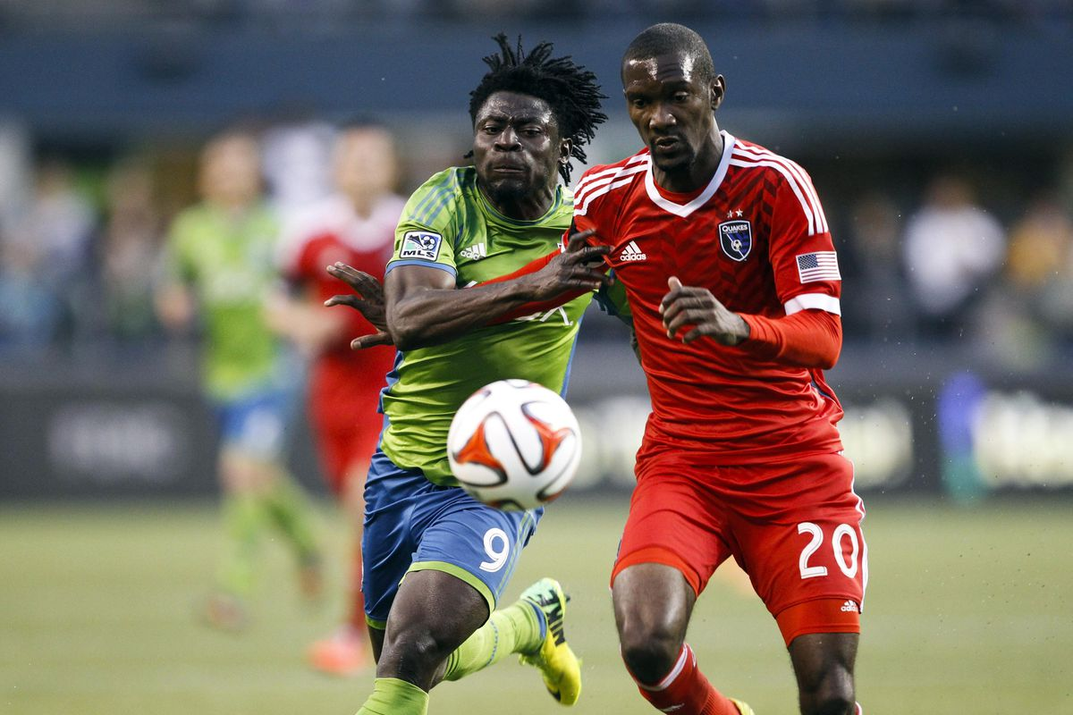 Obafemi Martins and Shaun Francis fight for position