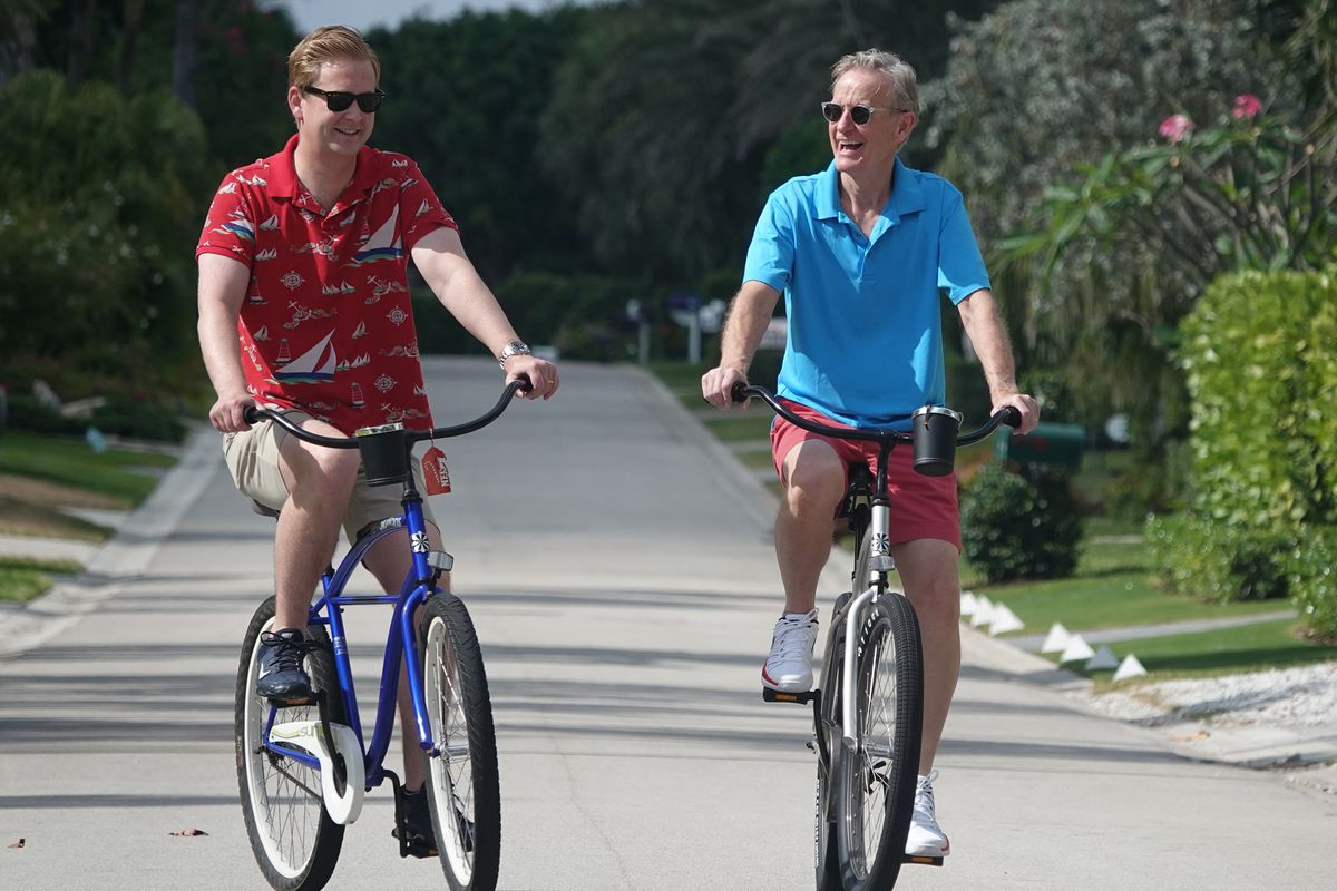 """Peter Doocy, a Fox News White House correspondent, and his father Steve, of """"Fox & Friends,"""" ride bicycles in Florida."""