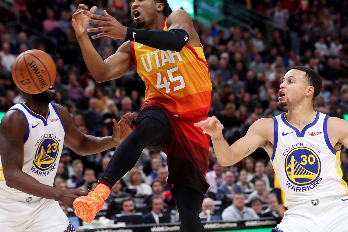 Utah Jazz guard Donovan Mitchell (45) is fouled by Golden State Warriors guard Stephen Curry (30) as the Utah Jazz and the Golden State Warriors play an NBA basketball game at Vivint Smart Home Arena in Salt Lake City on Wednesday, Dec. 19, 2018.