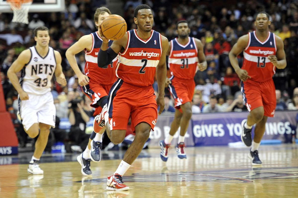 Apr 6, 2012; Newark, NJ, USA;  Washington Wizards guard John Wall (2) brings the ball up court against the New Jersey Nets during the first half at  the Prudential Center.  Mandatory Credit: Joe Camporeale-US PRESSWIRE