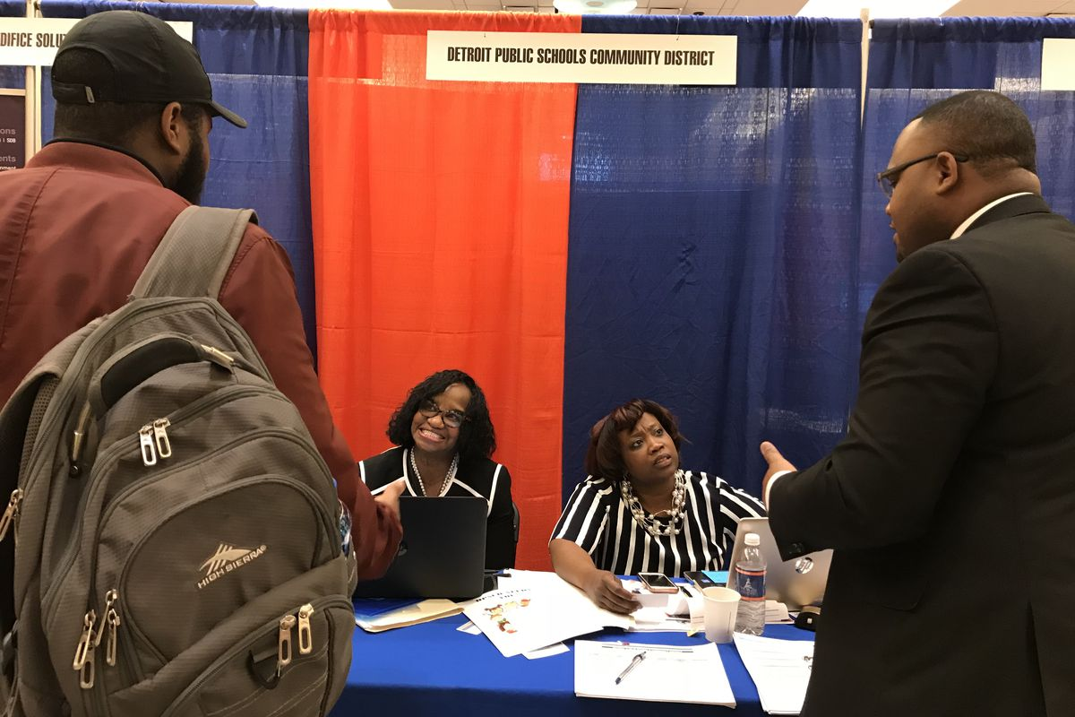 Recruiters Edwina Dortch and Asenath Jones chat with passersby at Morgan State University's spring career fair