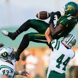 Kearns wide receiver Jeff Bassa (2) nearly catches a ball during a high school football game against Olympus at Kearns High School in Kearns on Friday, Aug. 28, 2020.