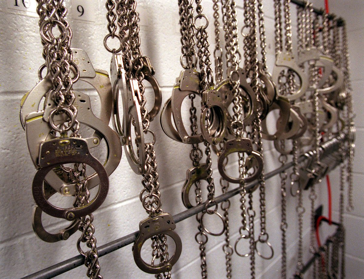 Handcuffs and shackles hang at the Utah State Prison in an undated file photo.