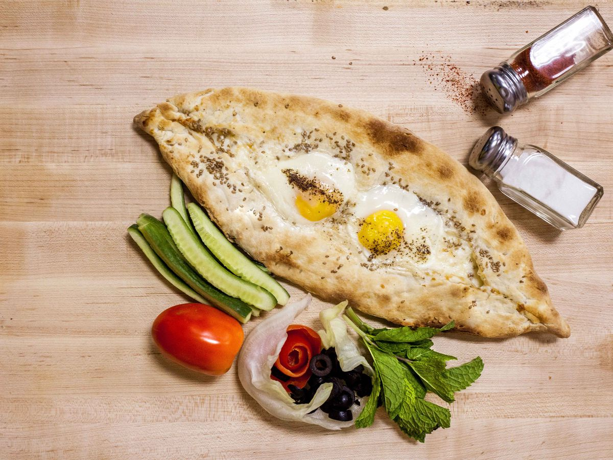 Adiarski mana'ish, a Lebanese flatbread topped with cheese and two eggs
