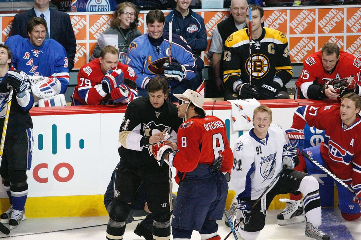 Alex Ovechkin and his fellow All-Stars, clearly having a horrible time (Richard Wolowicz / Getty Images)