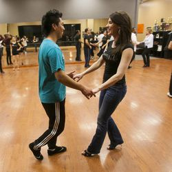 South Salt Lake Businesswoman of the Year Maria Ivanova helps Julio Morales Tuesday, March 12, 2013, at her dance studio, DF Dance.