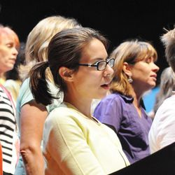 Danielle Tumminio, an Episcopal priest who grew up singing in choirs, rehearses with the Mormon Tabernacle Choir in Boston during the choir's recent tour to the area.