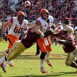 Pressure forces an awkward throw from the Syracuse QB.