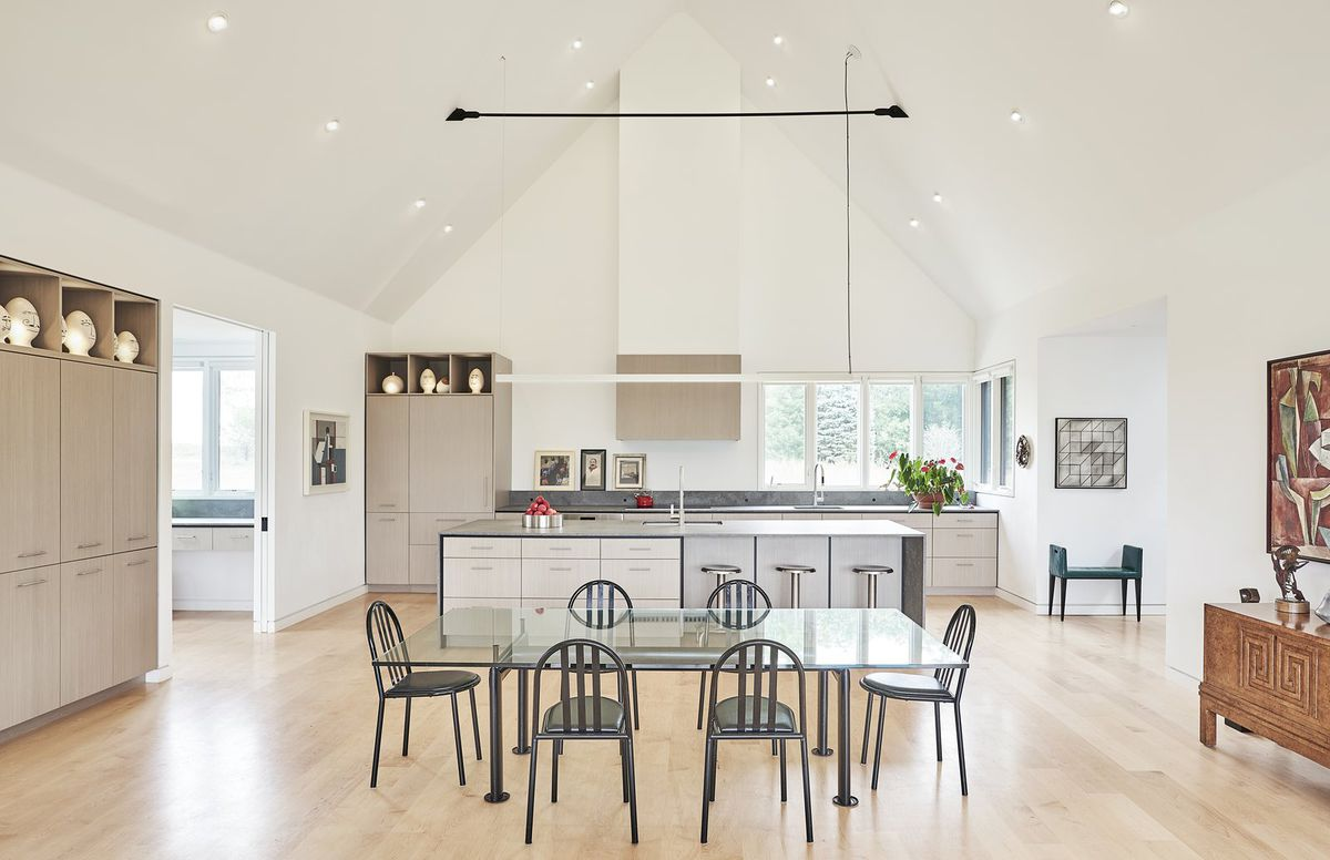 Open plan kitchen featuring dining table and island.