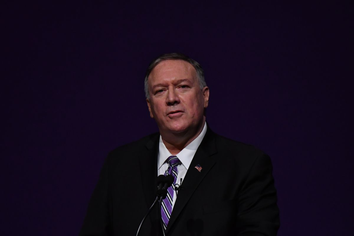 Mike Pompeo at a podium giving a speech in front of a black background.