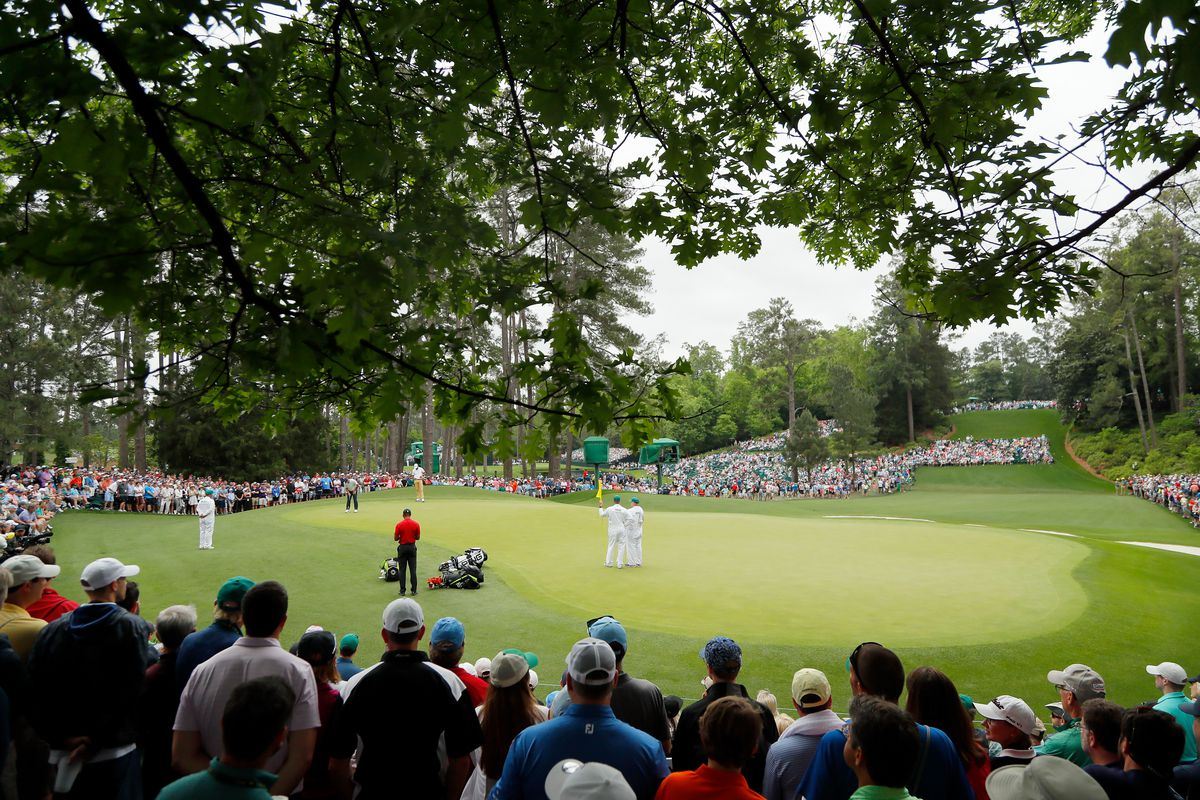 A general view is seen as Tiger Woods of the United States, Francesco Molinari of Italy and Tony Finau of the United States play the sixth green during the final round of the Masters at Augusta National Golf Club on April 14, 2019 in Augusta, Georgia.