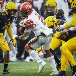 Utah Utes running back Zack Moss (2) escapes the tackles of the West Virginia Mountaineers secondary at the Zaxby's Heart of Dallas Bowl between the Utah Utes and the West Virginia Mountaineers in Dallas Texas on Tuesday, Dec. 26, 2017.