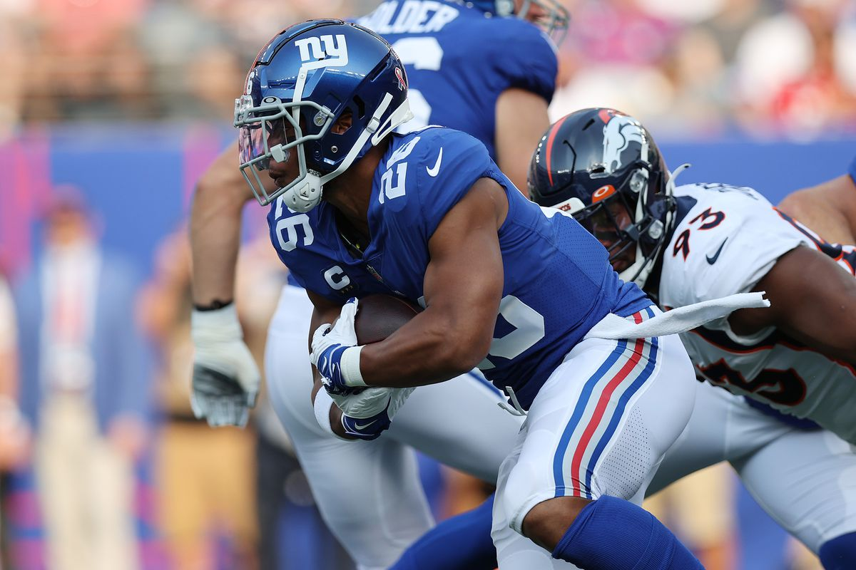 Saquon Barkley #26 of the New York Giants runs with the ball during the first half against the Denver Broncos at MetLife Stadium on September 12, 2021 in East Rutherford, New Jersey.