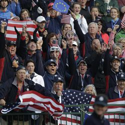 Fans cheer as USA's Bubba Watson tees off on the first tee during a foursomes match at the Ryder Cup PGA golf tournament Saturday, Sept. 29, 2012, at the Medinah Country Club in Medinah, Ill.