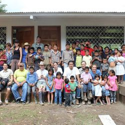 Members of Project Grace and Storytellers for Good take a break from building a school to pose for a group picture with school children while in Nicaragua. Project Grace helps people who have suffered the loss of a loved one heal through service and sharing, and Storytellers for Good was there to capture the event in pictures and video.