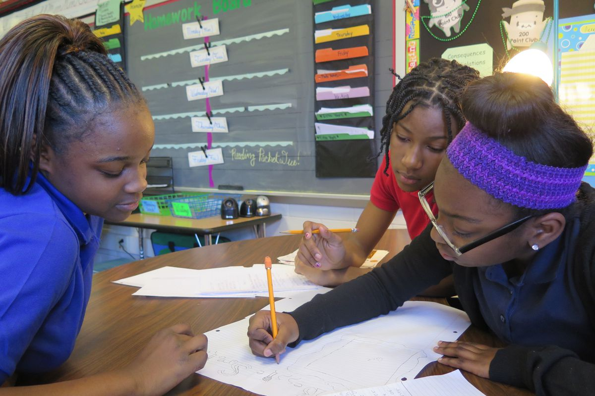 Students at School 48 work on a class project.