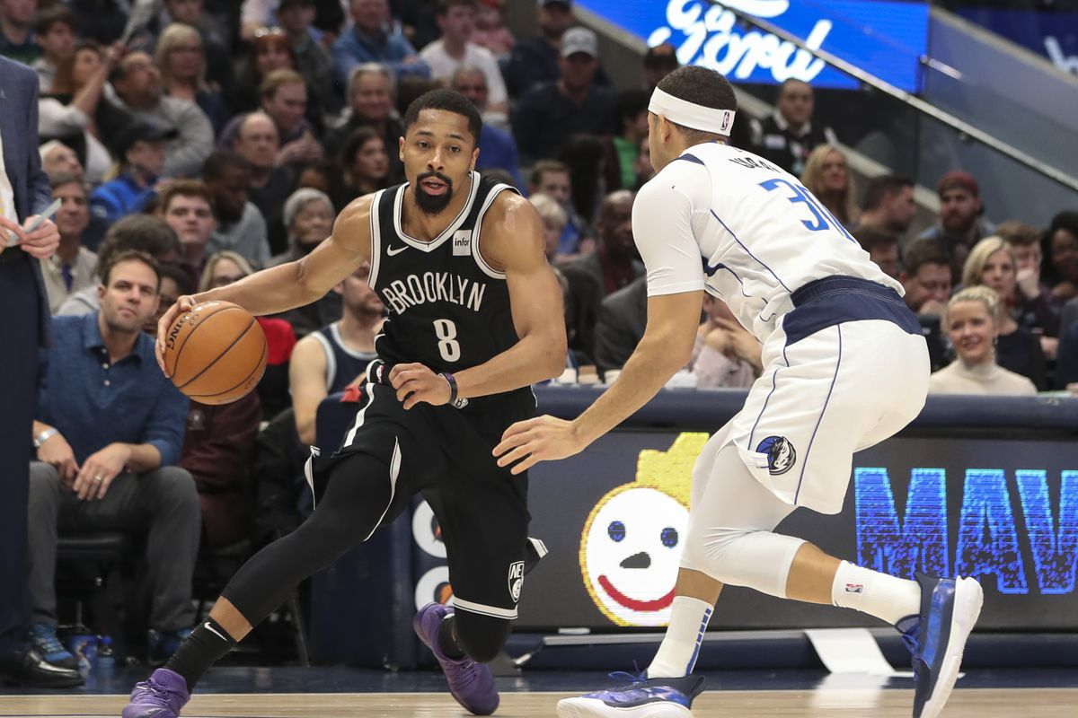 Brooklyn Nets guard Spencer Dinwiddie dribbles as Dallas Mavericks guard Seth Curry defends during the first half at American Airlines Center.