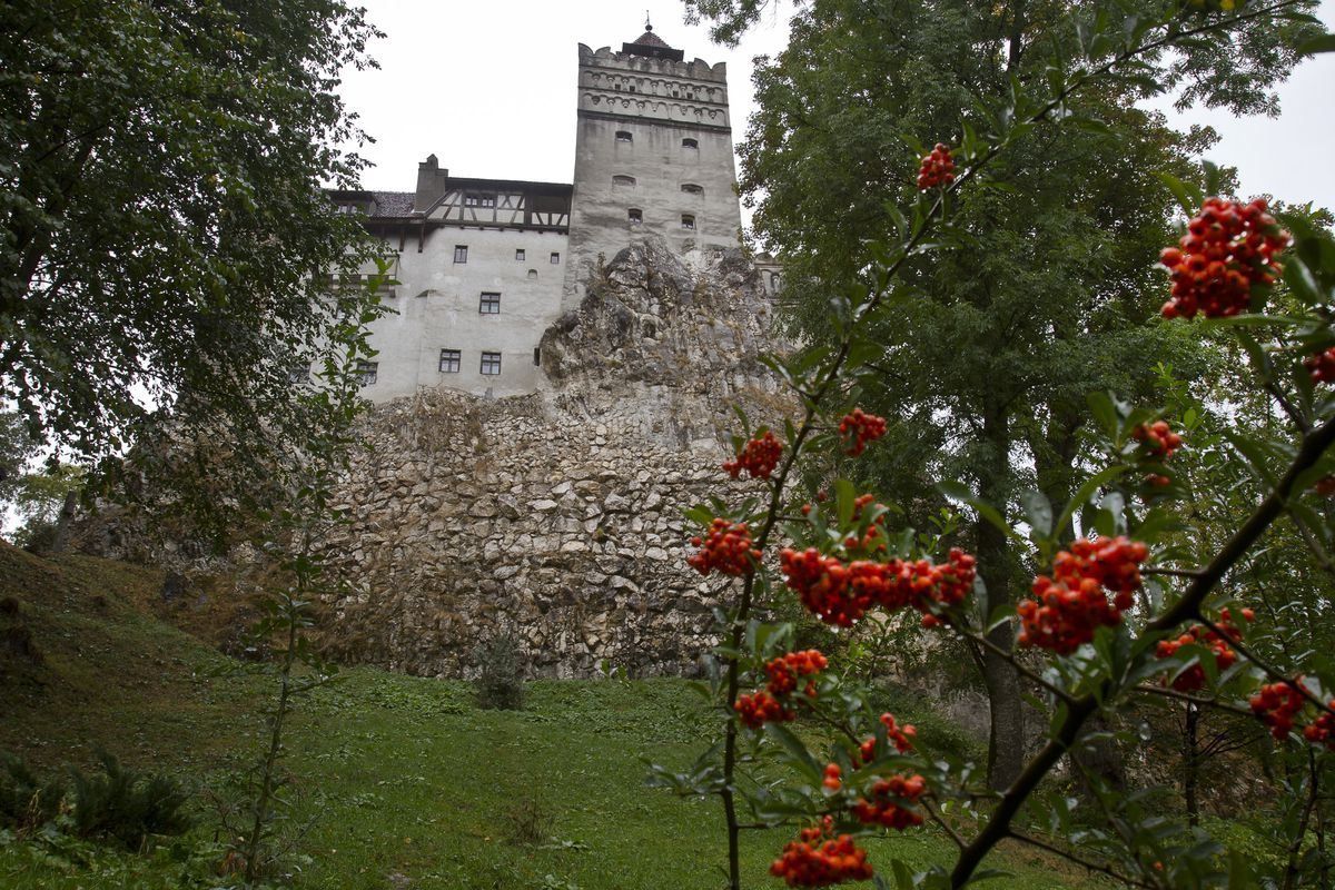 In this Saturday, Oct. 8, 2011 file picture, the Gothic Bran Castle, better known as Dracula Castle, is seen on a rainy day in Bran, in Romania's central Transylvania region. Romanian authorities have set up a COVID-19 vaccination center in a medieval building in Bran, not far from the castle, as a means to encourage people to vaccinate and also to boost tourism which has decreased in the area as a result of the pandemic.