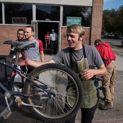 Workers from the Provo Bicycle Collective receive a donation of bicycles off a truck.