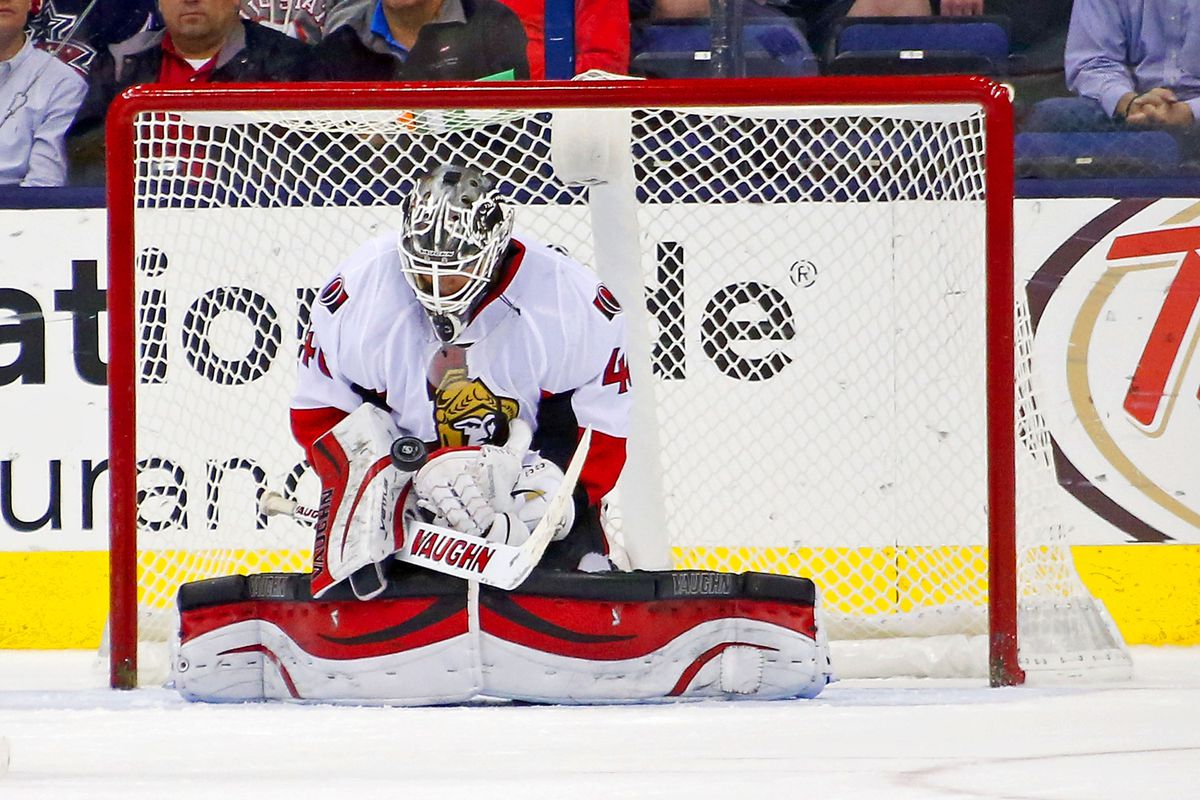 Robin Lehner attempts to create a diamond from a puck.