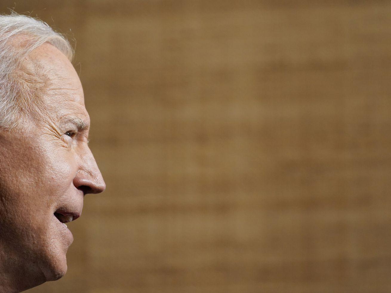 President Joe Biden, in profile while speaking.