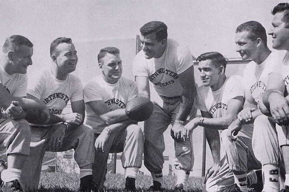 From left: Bo Schembechler (frosh coach), Paul Shoults (back), Dale Samuels (asst. frosh), Ara Parseghian (head coach), Doc Urich (line), Bruce Betty (tackle), and Alex Agase (defensive line).