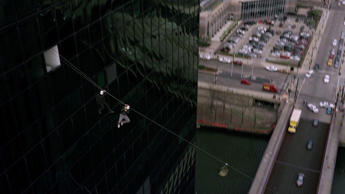The Dark Knight building swing IMAX bank heist opening