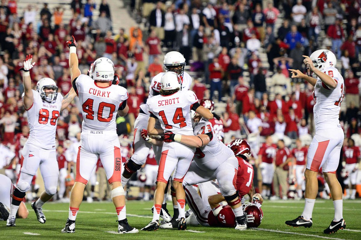 Sep 15, 2012; Bloomington, IN, USA; Ball State Cardinals kicker Steven Schott (14) celebrates with teammates after kicking the game winning field goal to defeat Indiana Hoosiers 41-39 at Memorial Stadium. Mandatory Credit: Andrew Weber-US Presswire