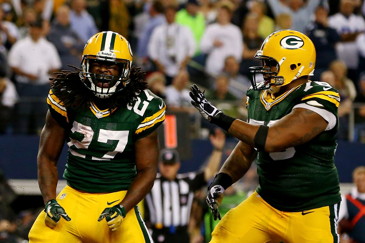 2013 draftee Eddie Lacy celebrates a touchdown with 2012 pick Mike Daniels.