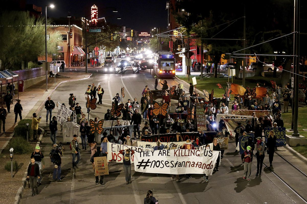 Protesters march through downtown in response to a jury finding U.S. Border Patrol agent Lonnie Swartz not guilty of involuntary manslaughter in the cross-border shooting death of Mexican teen Jose Antonio Elena Rodriguez, Wednesday, Nov. 21, 2018, in Tuc